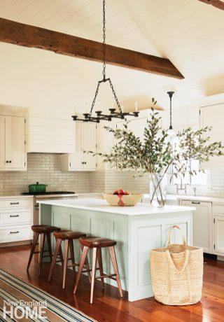 White kitchen with green island