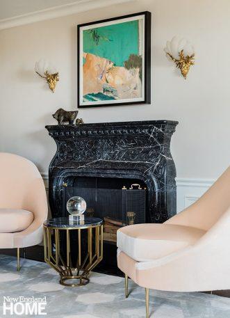 Custom black marble fireplace.