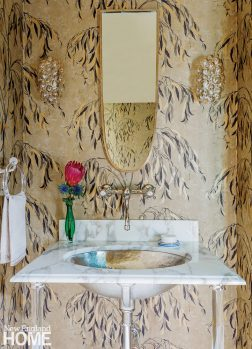 Powder room with botanical wallpaper.