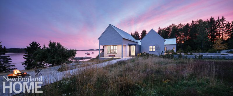 Contemporary coastal Maine home at twilight.