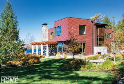 Exterior of a contemporary lake front home.