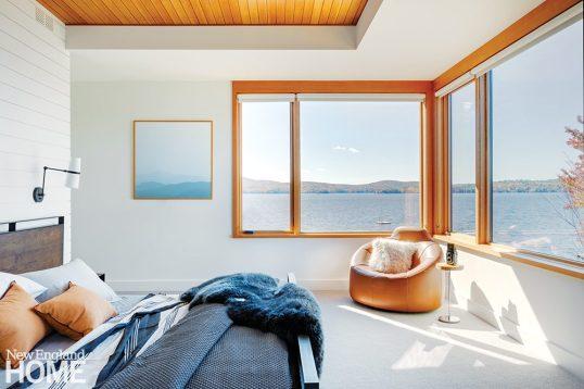 Minimalist bedroom overlooking Lake Sunapee.