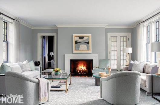 Contemporary living room with gray walls and neutral furnishings