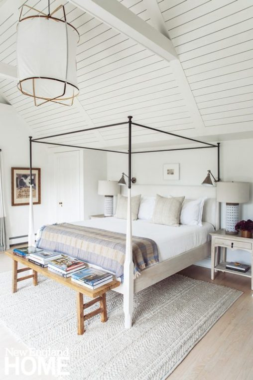 Primary bedroom with a large four poster bed.