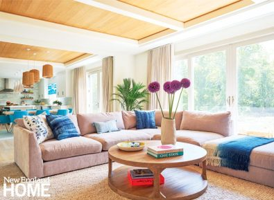 Family room with pale pink couch.