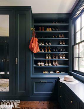 Closet painted dark blue.