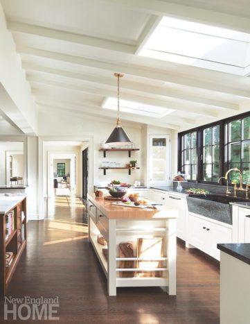 Sunny white kitchen with a butcher-block prep island