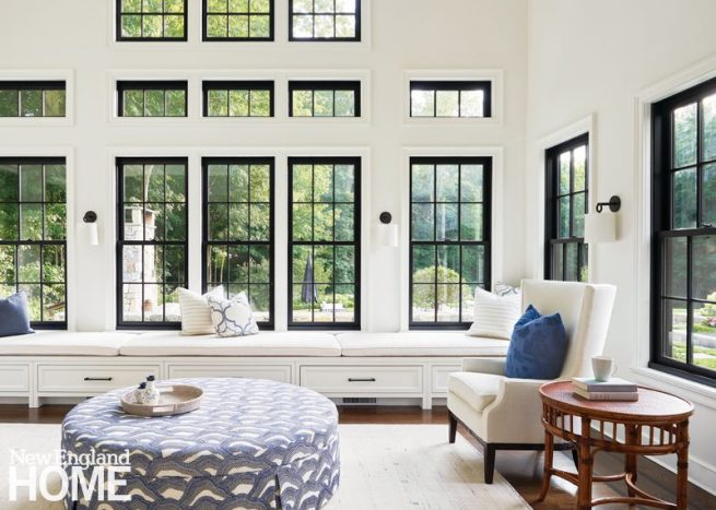 large living room with white walls and black windows