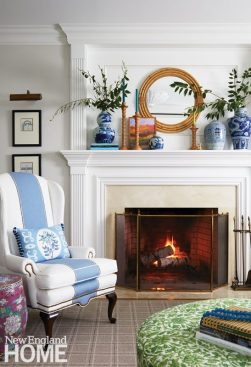 Traditional fireplace with blue and white wingback chair