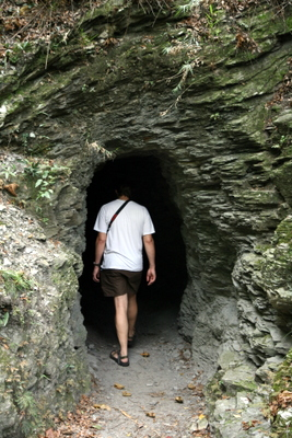Man walking into a dark cave