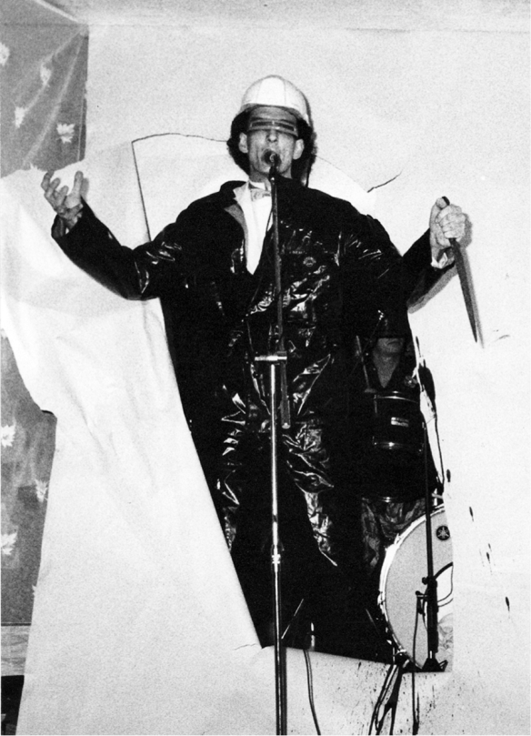 Opening number of the Extremists, Neil arriving through a film screening of a volcanic eruption at the Zap at the Royal Escape, 1982 image: Richard Paul Jones