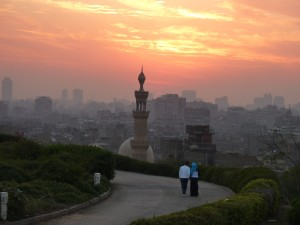 Couple watching the sunset over Islamic Cairo