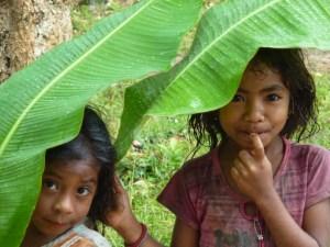Village girls sheltering from the rain, Nome, West Timor, Indonesia for neildonovan.net