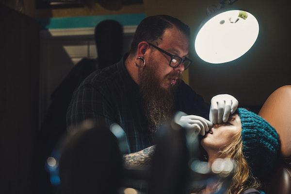 girl gets nose pierced
