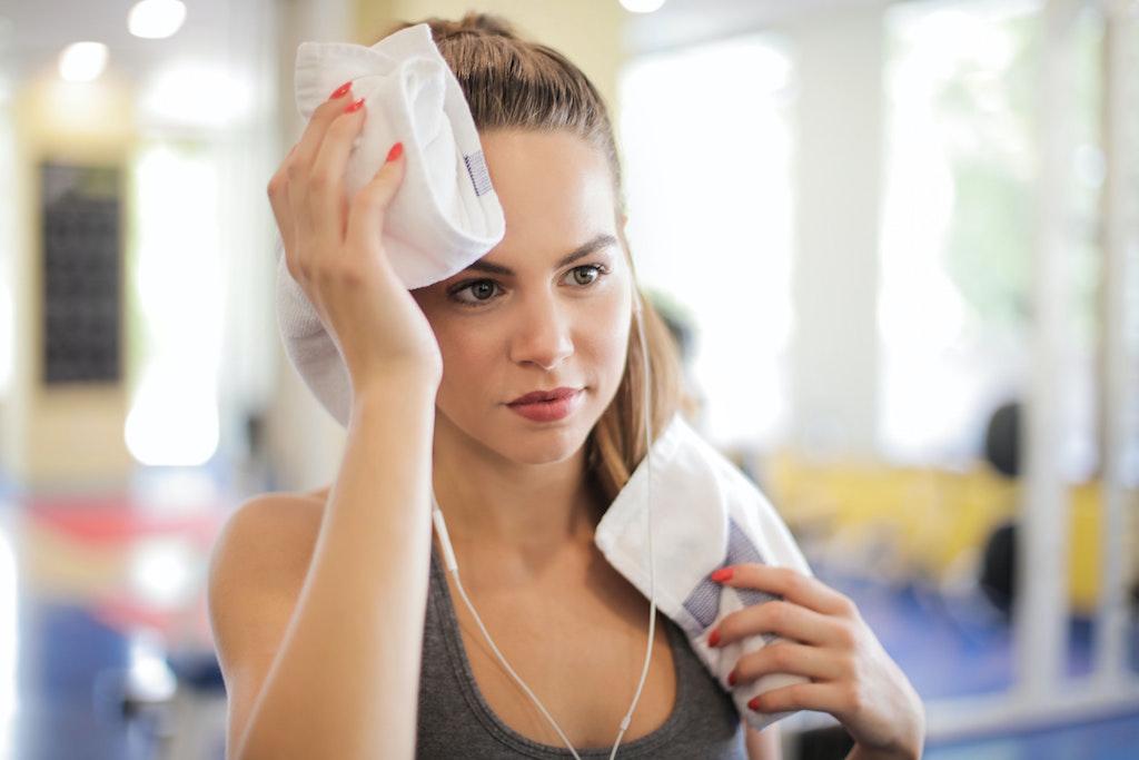 woman wiping away sweat
