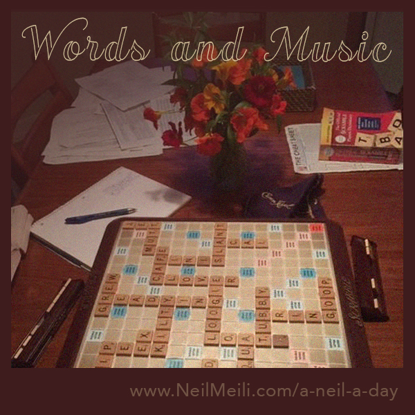 Words and music  Scrabble game with a bouquet of flowers