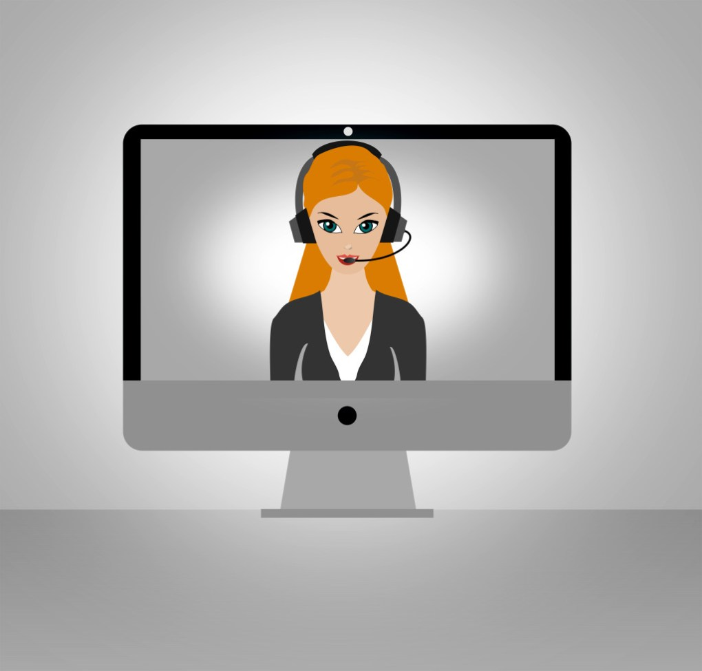 a women with a headset on a computer screen