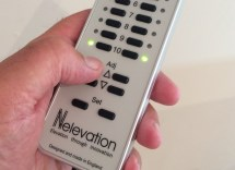 Nelevator remote control held in hand