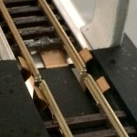 Self cleaning beryllium copper electrical contacts on the Nelevator N gauge railway tracks