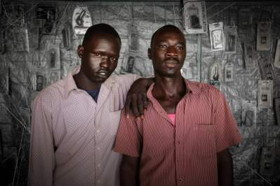 Two South Sudanese shopkeepers in Warawar, South Sudan - one Din