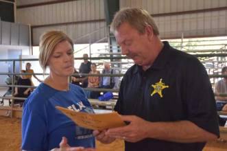 Union County Sheriff Jimmy Edwards presented Relay for Life worker Vicki Duke with $635 in contributions collected from inmates and sheriff's office staff at the county jail.