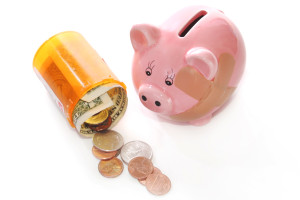 stockvault-piggy-bank-with-pill-bottle127632