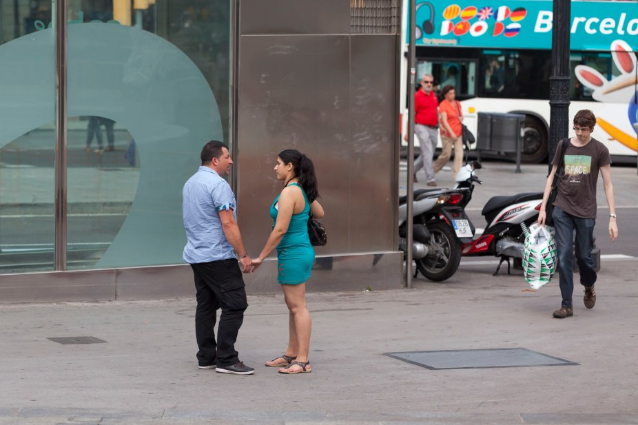 Barcelona Couple Holding Hands