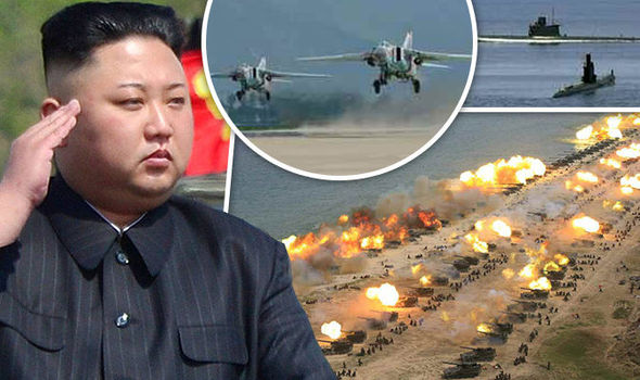 submarines emerge from the water off port town of wonsan as jets take off and land