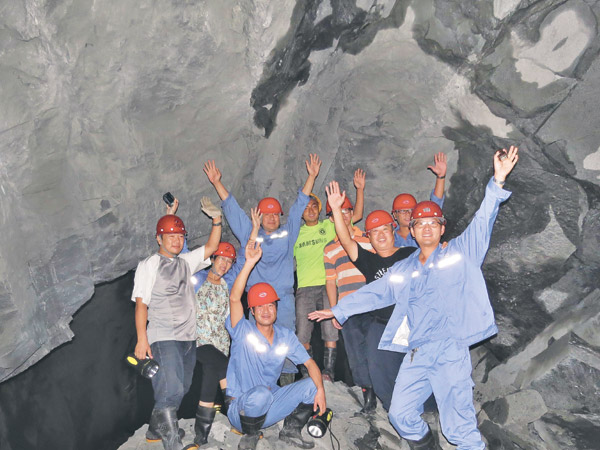 Tunnel workers celebrate the breakthrough