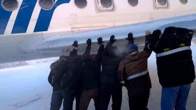 Passengers pushing aircraft (Meanwhile in Russia)