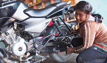 Kamala in her motorcycle repair shop