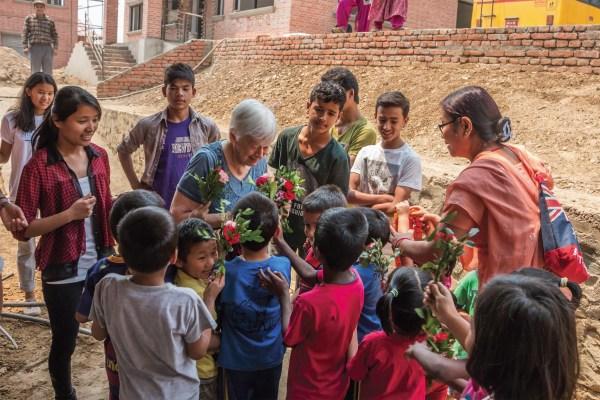 Olga with kids at OPV homeless children's shelter