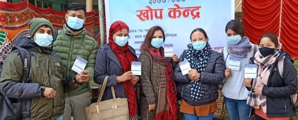 Vaccines arrive in Nepal! In early February 2021, our Nutritional Rehabilitation Home staff members display their new COVID vaccine cards.