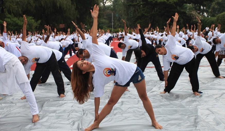 People practise yoga on the first International Yoga Day in Kathmandu, Nepal, June 21, 2015. (Xinhua/Sunil Sharma)