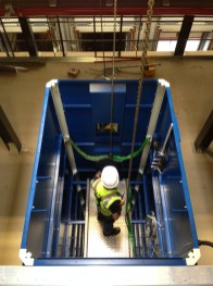 Engineers working in the lift shaft during installation