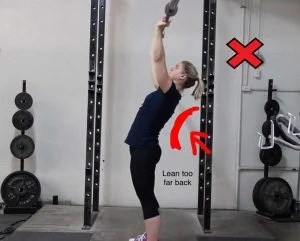 Lean back by engaging your hips, not by arching your back like shown.