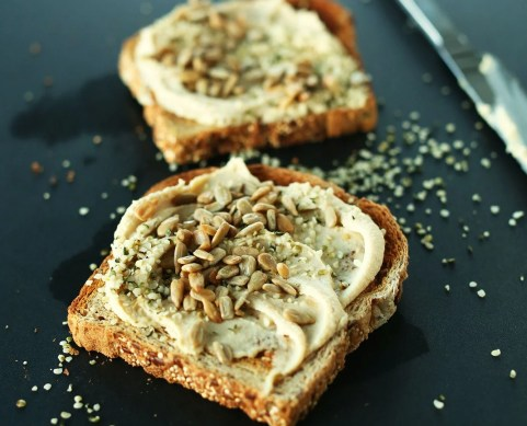 Hummus and toast is a great snack, whether you're going vegan or not.