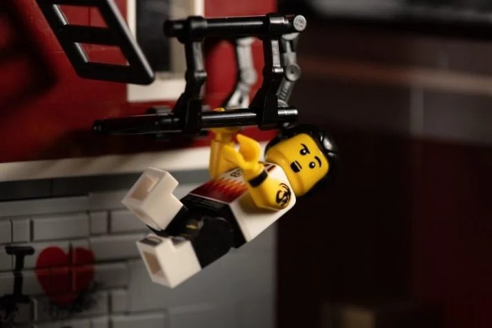 This LEGO knows lifting himself up is a great advanced bodyweight exercise.