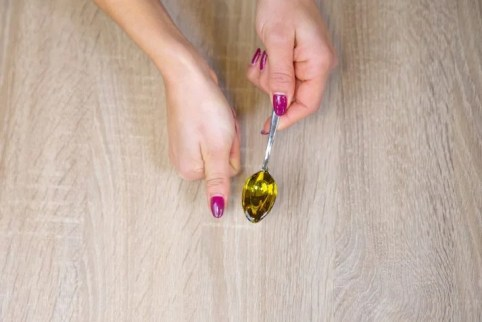 A thumb sized portion of olive oil is around 60 calories - from Runtastic