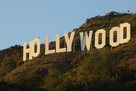 Hollywood: the land of movie premiers, double-decker tourist buses, and sidewalk characters. [Wikipedia]