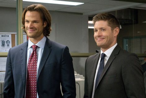 Sam and Dean are smiling now, but those grins don't appear when the brothers debate God and the Darkness [Source: Liane Hentscher/The CW]
