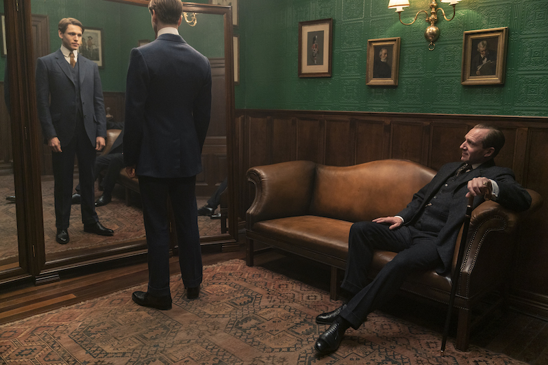 Harris Dickinson as Conrad and Ralph Fiennes as Oxford in 20th Century Studios' THE KING'S MAN