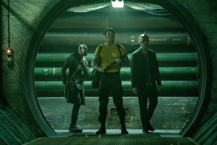 Still frame of Daniela Melchior, Joel Kinnaman, and Peter Capaldi