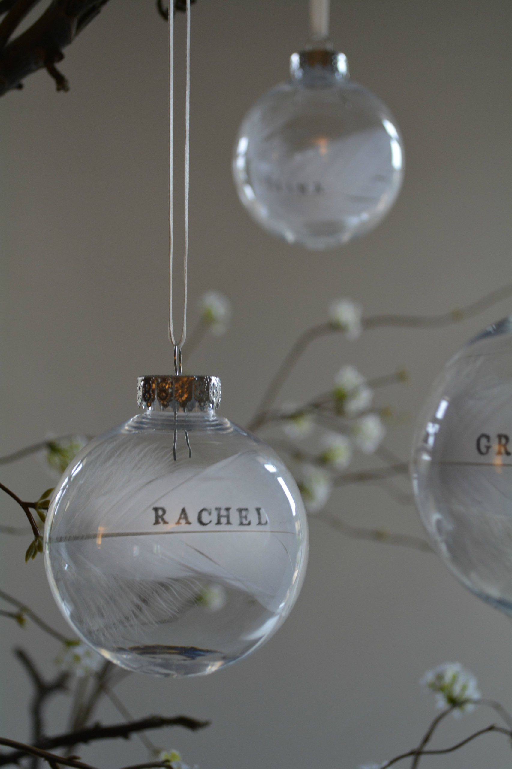 Glass Bauble With Personalised Feather Wedding Favour