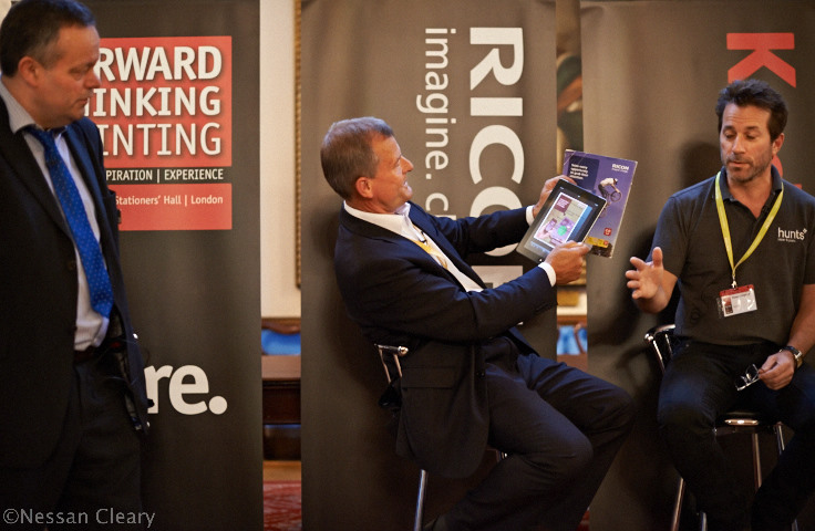 Throughout the day there was talk of the way that digital and print technologies could work together. Graham Moore, managing director of Ricoh UK, demonstrated Ricoh's Clickable Paper technology, which has moved on from QR codes and allows you to point an iPad at a printed ad that will then take you to a website. Gareth Ward, editor of Print Business (left) and Timon Colgrove, managing director of Hunts (right) look on.