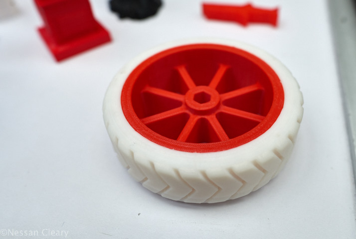 This wheel uses a hard plastic like PLA but with the tyre printed with Verbatim's  rubber-like Primalloy.