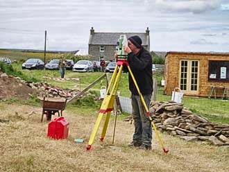Dan sets up the Total Station to record 3D some of the numerous finds.