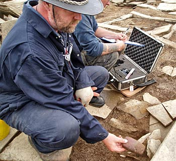 Ray recovers another beautiful polished stone artifact from Structure 8.