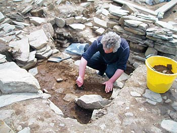 Prof Mark edmonds reveals more of the inner wall of St 10 under robbing debris.