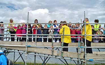 Rangers Sandra and Keith explain the wonders of the Ness to Stenness Primary School